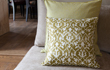 Mustard coloured, patterned cushions